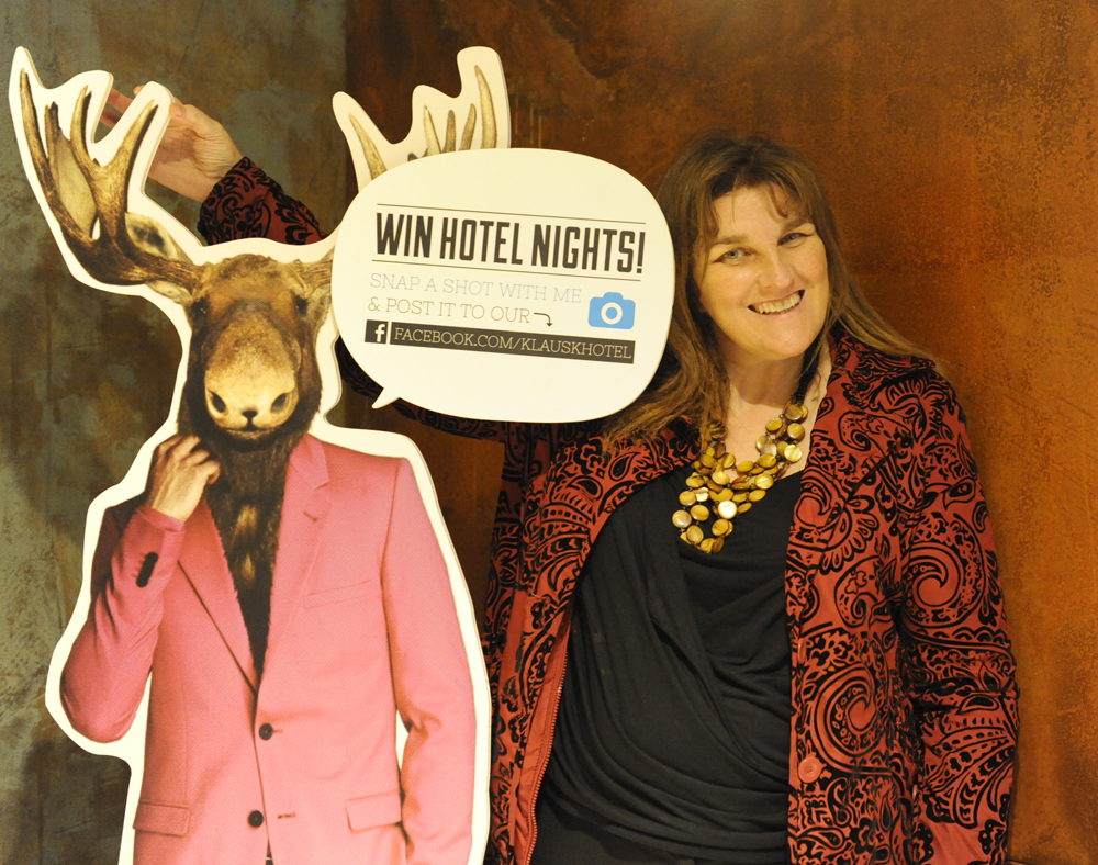 Only In Finland. A life-sized cardboard cut-out of a man wearing a smart jacket with reindeer horns