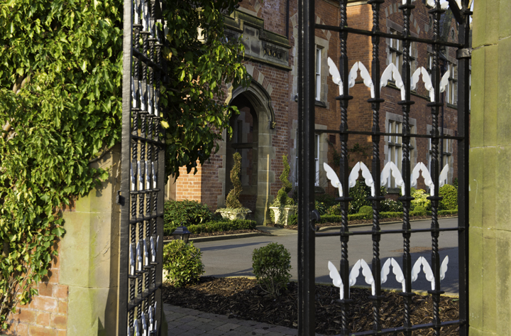 The elaborate wrought-iron garden gates