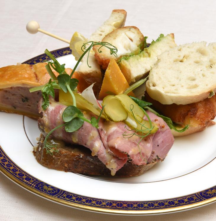 Floured bloomer, crispy haddock, tartar sauce Open rye, roast beef, pastrami, mustard and pickles Baked pork and apple savoury, Appleby's Cheshire cheese