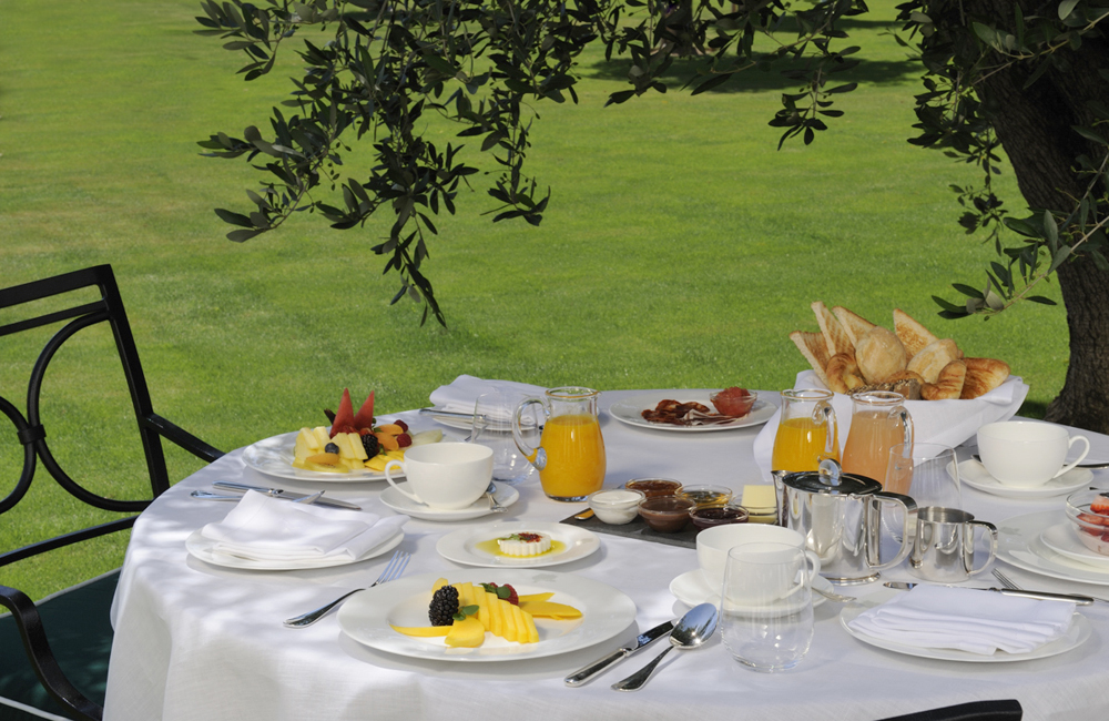 Breakfast on the lawn at Finca Cortesin